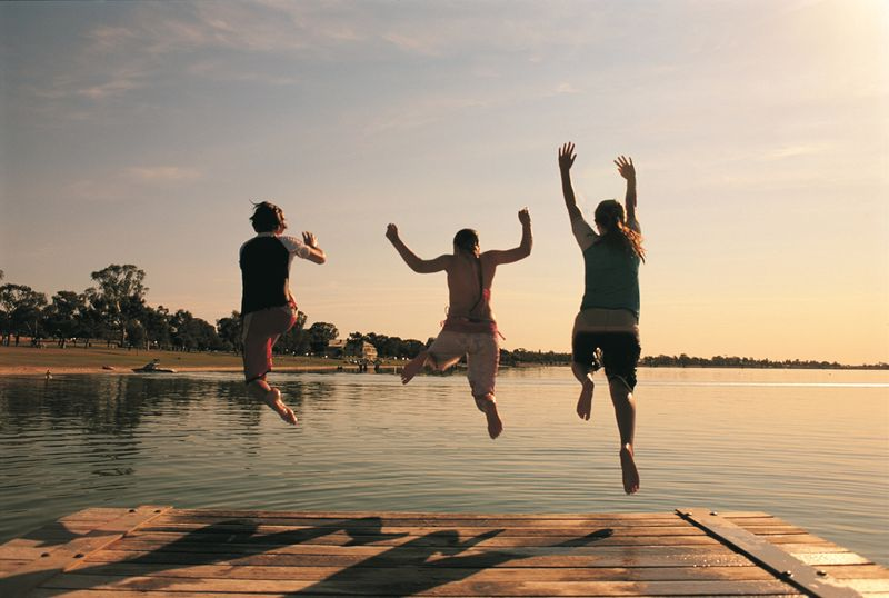Lake Bonney with swimmers jumping in